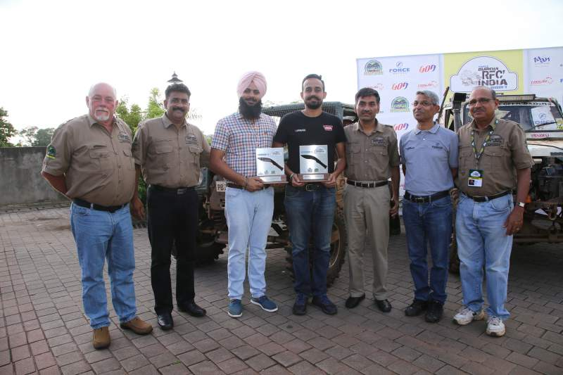 Sanbir Singh Dhaliwal (4th from Left) and co-driver Gurpartap Singh (3rd from Left)